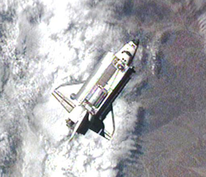 Space Shuttle Discovery prior to docking with International Space Station. Image by NASA.