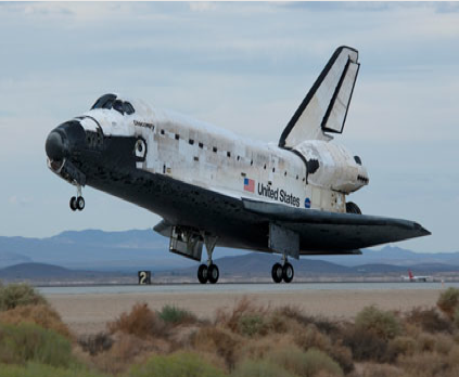 Space shuttle Discovery lands at Edwards Air Force Base in California. Image Credit: NASA/Tom Tschida