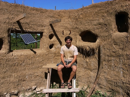 A satisfied -- and tired -- homeowner/builder after the completion of the cob walls. Image courtesy of Brian Liloia.
