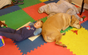 Doggie and toddler relaxing